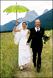 Bide and Groom with umbrella, Canmore